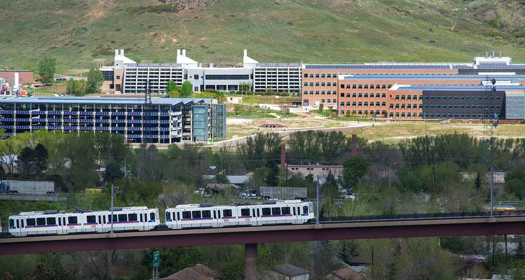 Photo of the light rail in the foreground and NRELs South Table Mountain campus in the background.