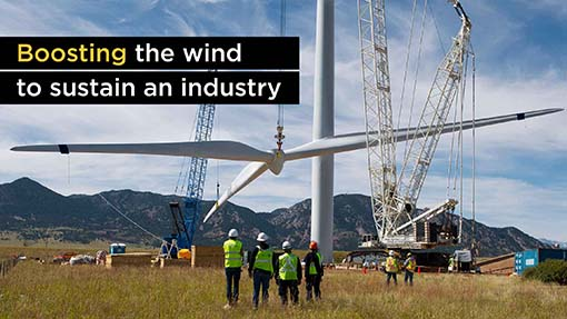 A photo of the assembly of a wind turbine.