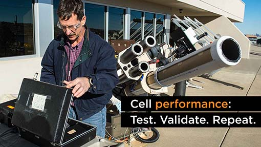 A photo of a NREL researcher with a solar measurement technology.