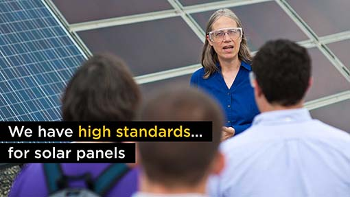 A photo of Sarah Kurtz, NREL Solar Scientist, speaking to people next to solar panels.