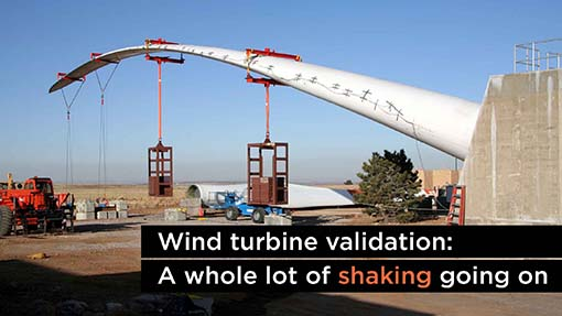 A photo of a wind turbine blade tested with weights.