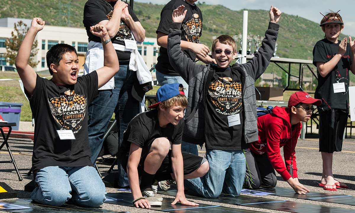 A photo of students competing in NREL's Solar and Lithium Ion model car races in Colorado.