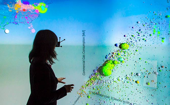 Researcher using visualization tools at NREL.