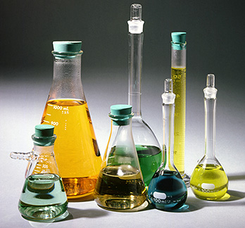 Photo of laboratory glassware with colored liquid chemicals