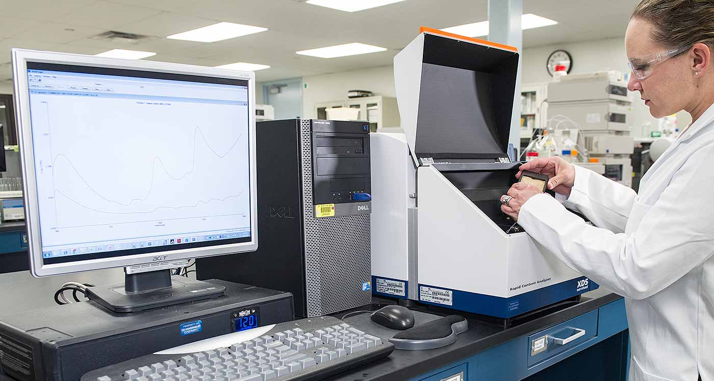 woman working with sampling equipment in a lab