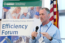 Photo of Walmart's Jim McClendon speaking during the Commercial Building Energy Alliances Executive Exchange with Commercial Building Stakeholders forum at NREL in Golden, Colorado, in May 2012.