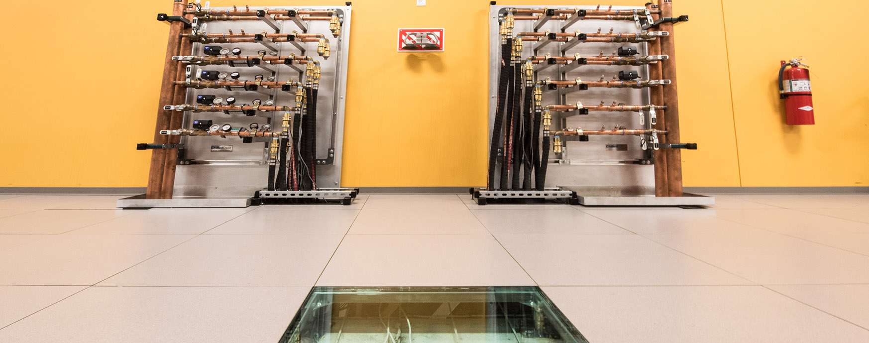 Photo of hot aisle containment manifolds in data center providing energy recovery water