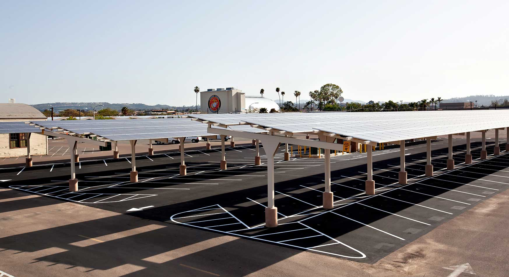 Raised solar panels shade a parking lot