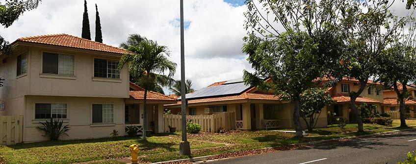 Photo of a home with a rooftop solar system in a residential neighborhood in Hawaii.