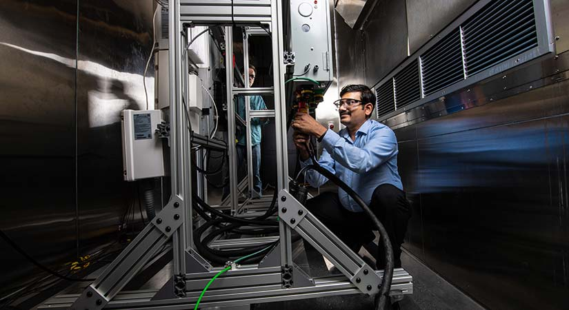Photo of a researcher working on the residential battery test bed in the Energy Systems Integration Facility.