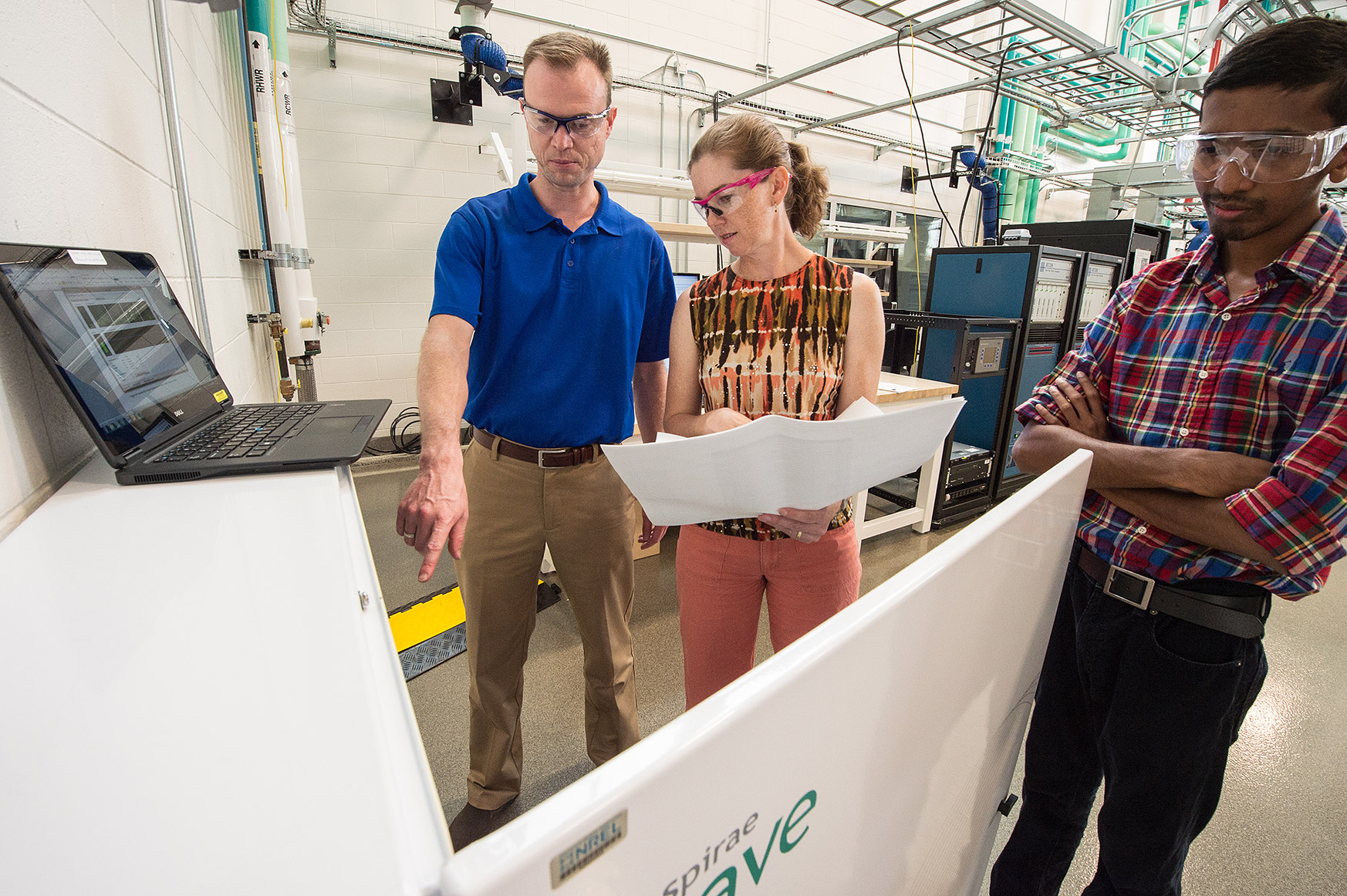 NREL researchers work to validate performance of Spirae-developed microgrid controller in partnership with EPRI in the ESIF.