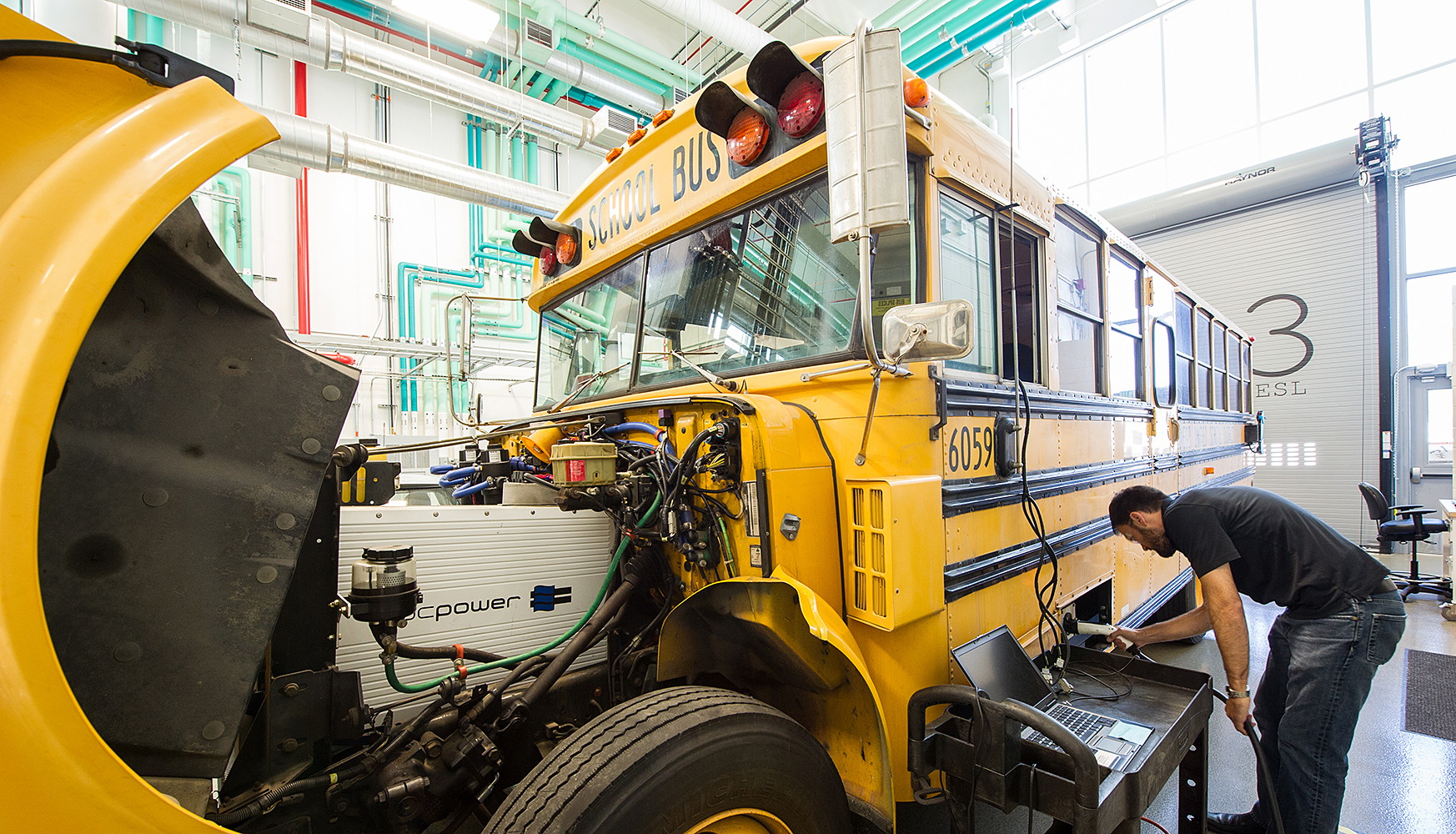 Electric school bus under study at the Energy Storage Lab at NREL's Energy Systems Integration Facility, featuring vehilce-to-grid integration capabilities enabling it to feed power back to the grid and essentially serve as a mobil power generator.