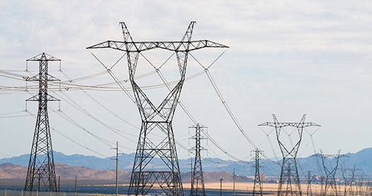 Transmission lines near a mountain range.