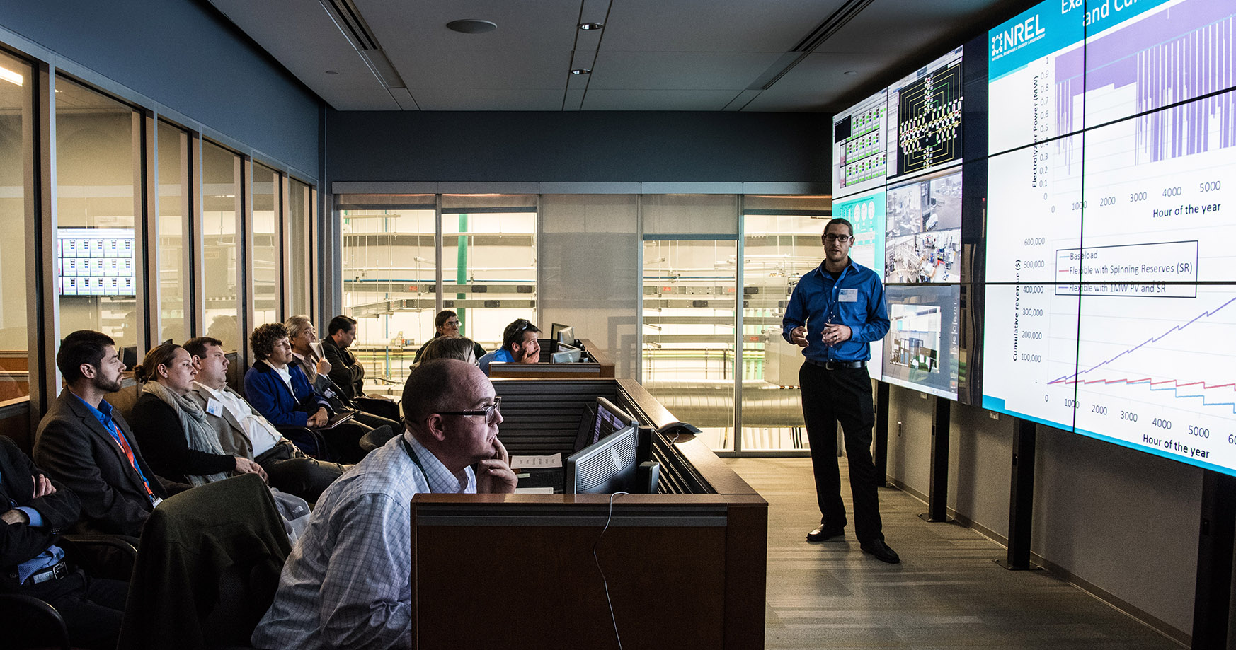 Photo of an NREL researcher presenting in the Energy Systems Integration Facility Control Room.