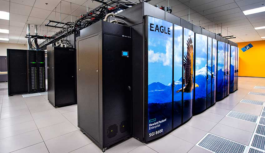 Computer stacks enclosed with doors that feature an image of an eagle flying in front of a mountain range across them