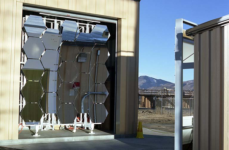 Photo of NREL's solar furnace primary concentrator and protection shed.