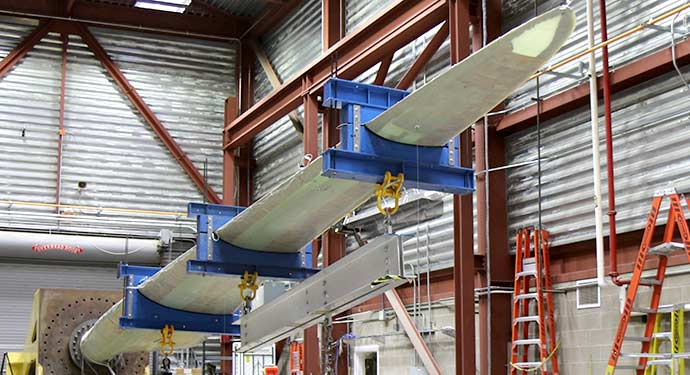 A wind turbine blade undergoing testing the NREL's National Wind Technology Center.