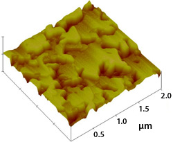 High-resolution, three-dimensional image of sample gallium phosphide on silicon device; the image was obtained using atomic force microscopy and features several densely packed yellow and red elevated areas that appear three-dimensional.