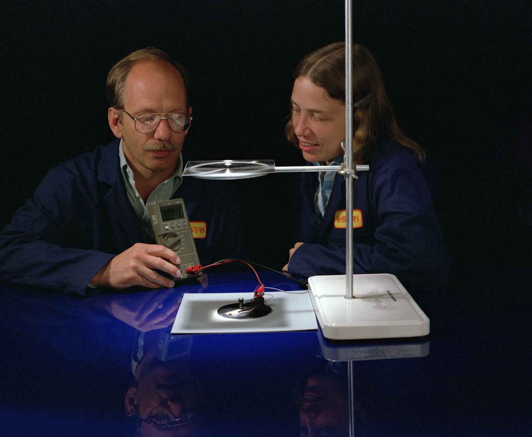 A man and woman conduct an experiment.