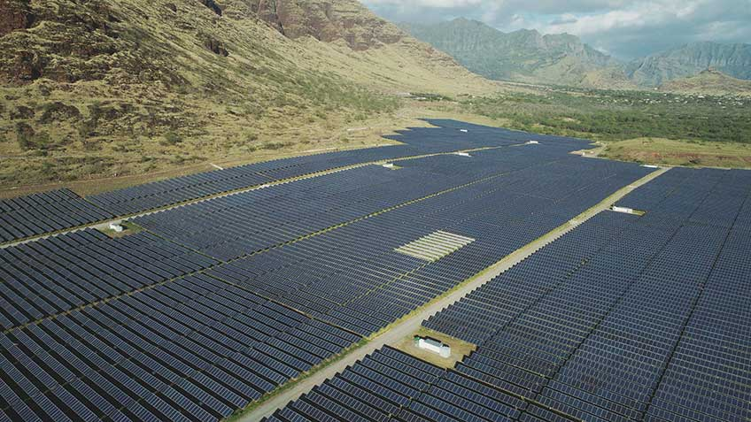 Aerial photo of a utility-scale solar power plant in a tropical environment.