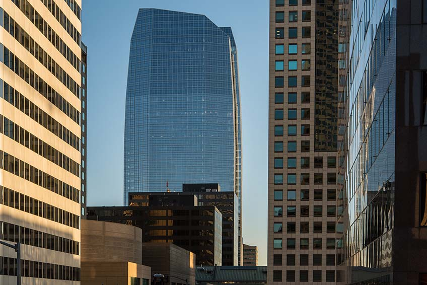 Photo shows skyscrapers in downtown Denver.