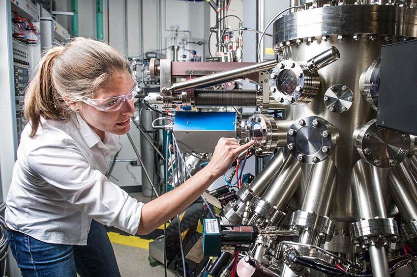 A researcher working with equipment in the lab.
