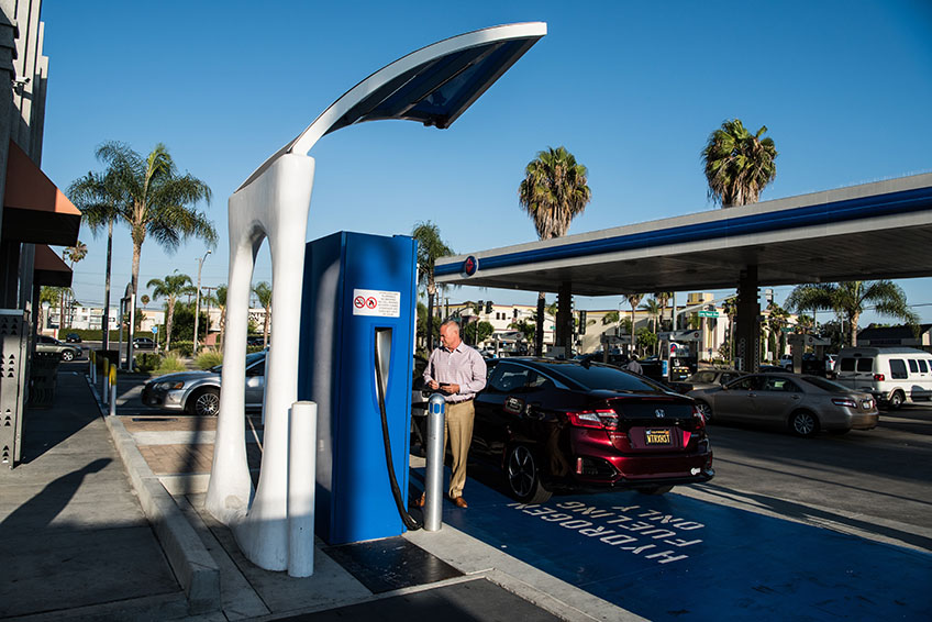 A man fuels his car at a hydrogen pump at a station in California.