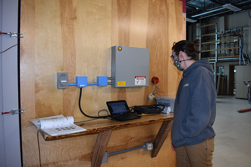Photo of a researcher calibrating a cold chamber