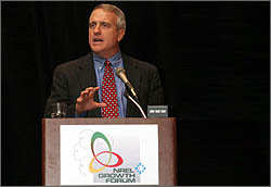 Photo of Colorado Governor Bill Ritter standing at a podium with NREL's 20th Industry Growth Forum logo on it.