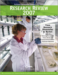 Image of the cover of the NREL Research Review 2007, featuring a photo of a man and a woman in lab coats in an algae culture room, which consists of several stacked glass shelves with fluorescent bulbs mounted between them. Standing between two long rows of shelves, the woman examines a square plastic culture dish, while splotches of green algae are visible in dozens of culture dishes on the shelf in front of her. In the background, the man holds up and examines two flasks containing a milky green liquid. Text on the cover says 'From Research Discoveries to Market' and then lists five items: Innovation, Technology Development, Product Development, Commercial Demonstration, and Large-Scale Deployment.