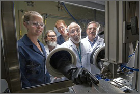 Photo of scientists looking into a chamber