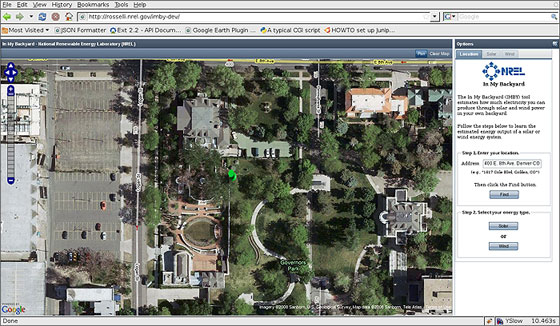 Image of a computer screen with an aerial photo of a parking lot on the left, several roofs and a park. To the right of that image is text in the In My Backyard software tool.