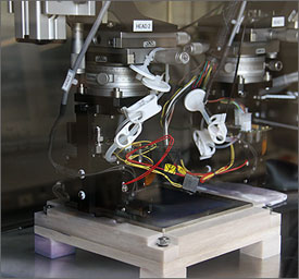 Photo of an ink jet sprayer assembly used for making thin film solar cells.