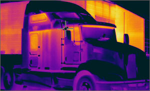 Infrared photo of a long distance truck's cab and sleeper cabin showing heat loss.