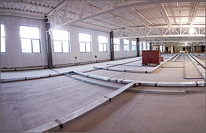 Photo of an office space under construction with large windows.