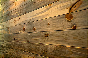 Photo of a treated pine wood wall.