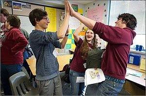 Photo of three teens sharing a high-five.