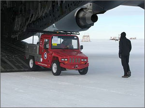 Photo of an electric vehicle being driven off a cargo plane.
