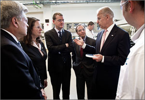 Photo of a US Vice President Joe Biden with NREL Director Dan Arvizu Colorado Congressional members and NREL staff.