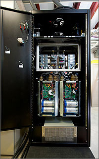 In this photo, the 50 kW Power Block is about a third the size of the entire inverter cabinet, which has its door wide open and has racks for holding other components.