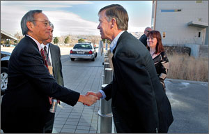 Photo of two men shaking hands.