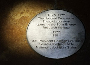 Photo of the sun hitting a medallion on the floor of a building at NREL.