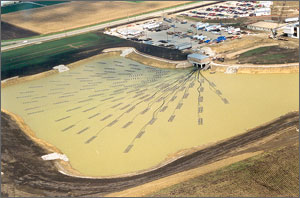 Photo of a large pond with many energy devices floating in it.