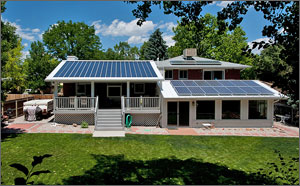 This is a photo of a 1950s-era ranch-style house dominated by solar panels on almost every square foot of the roof.