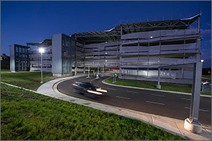 This photo shows a four-story parking structure at dawn with minimal lighting and energy use.