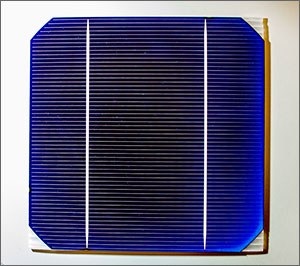 This is a close-up of a solar cell. It is mainly purple and blue with more than 60 white horizontal lines; two wider white vertical lines run from the top to the bottom of the cell.