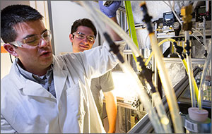 Photo of two men in a laboratory setting.