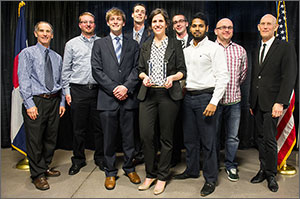 Photo of eight men and one woman, including the winning Montage Builders Northern Forest team.