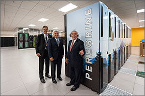 Photo of three men standing in front of NREL's Peregrine supercomputer.