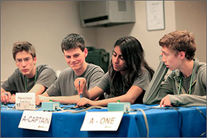 Photo shows four students sitting at a table during the National Science Bowl competition.